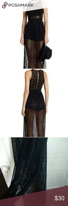 Sleeveless Lace Maxi Dress Floor length lace/knit maxi dress with slip shorts attached. Slit in both sides from knee down. Zips with a button in the back, and features a semi-open back. Sleeveless. Never been worn. Flying Tomato Dresses Maxi