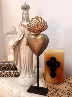 This is Single piece of vintage looking religious Milagros ex votos style flaming heart on stand. It is approximately 11 1/2 inchs tall by 3 1/2 inchs wide on stand. It opens as seen in photo. This is a Lockett style Milagros and the heart opens at the front to reveal a secret hiding place for your offerings and prayers or miracles.  All monitors show colors differently, this piece is a hue of brass / gold color. Other items in photo are for stagging, you will receive one Mila...