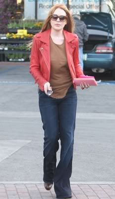 Lindsay Lohan must love pink Prada, and she was spotted carrying a Prada pink leather wallet in West Hollywood on March 8th, 2012. She also wore an Iro Ashville Shrunken Coral Leather Jacket which I think clashes with her red hair (but she looks much better as a redhead than a bleached blond) with a brown tee and jeans.
