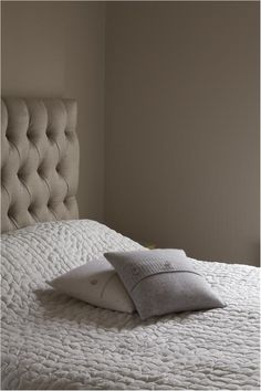 An inspirational image from Farrow and Ball - A bedroom in Skimming Stone nr 241 Estate Emulsion.