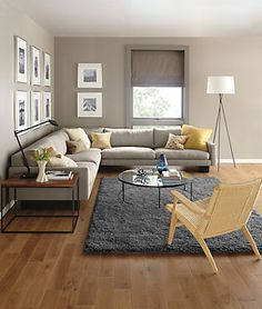 Love the layout, gallery wall, and furniture (Room&Board) of this well-styled living room.