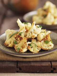 Crispy Parmesan Cauliflower | 1 head cauliflower, broken into medium florets, 2 cups all-purpose flour, 1 quart vegetable or canola oil, 2 teaspoons salt, 1 cup shredded Parmesan Reggiano, 4 tablespoons parmesan cheese (to garnish), 4 eggs, beaten (mix parmesan and egg together), 1 tablespoon chopped Italian parsley (for garnish), Lemon zest of 1 medium lemon