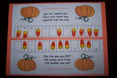 Candy Corn Game.. roll the dice and eat the candy on that number.. first one to eat all their candy wins!