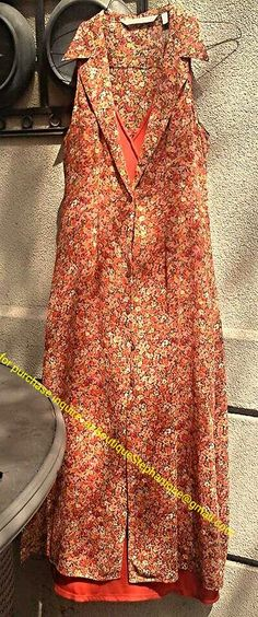 Vintage 80's Victoria secrets 2 piece vintage boho grunge dress. Size med under dress is a plain bright orange and over shirt/dress is a beutiful sheer floral wear together or seperate. If interested in this item please contact me at the addtess written on photo.   $40.00 + shipping