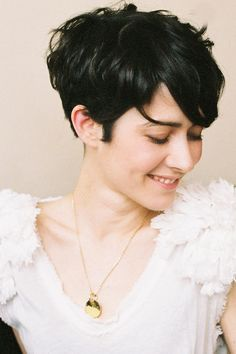 I REALLY want to try a pixie cut. Just to see what it would look like. And I want to do it now before it just looks like an older lady mom-do.