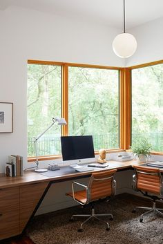 This modern home office has been designed for two people with views of the surrounding parkland. #HomeOffice #InteriorDesign