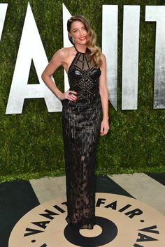 Amber Heard wore a #versace gown to the Vanity Fair #oscars party.
