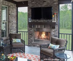 A cozy screened porch with fireplace is perfect for cool evening, whether you're relaxing or entertaining. The Spotswood - Plan 1310. http://www.dongardner.com/house-plan/1310/the-spotswood. #ScreenedPorch #Fireplace #OutdoorLiving