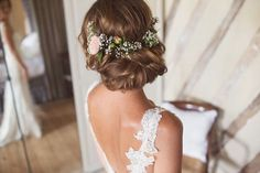 Chic bridal up do chignon roll, finished with fresh flowers - Pronovias Wedding Dress And Veil For A Pastel Themed Destination Wedding In Bergerac France With Groom In Suit By Moss Bros And Images By Cotton Candy Photography:
