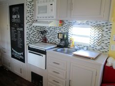 Smart tiles, chalk board fridge, grey camper cabinets. Tiny microwave over vent hood. Great ideas!