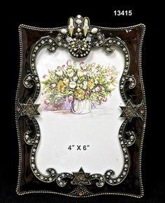 Frame/Hamsa Brass/Pewter  Glass Enameled  White Pearls  Swarovski Crystals/Austrian Crystals  Handmade in Asia $22