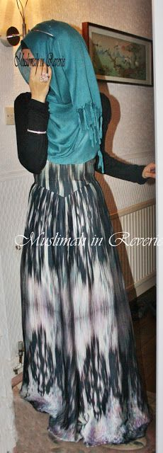 Black and white dress.  Teal hijab