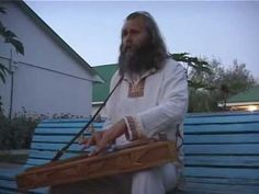 Slavic instrument -- Gusli -- played by a guy with a great voice.