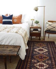 Global bohemian bedroom design in neutral color scheme with lots of texture Featuring a rustic wood bench, Moroccan wedding blanket, and antique rug - Modern Global Home Ideas & Decor Home Bedroom, Bedroom Furniture, Bedroom Decor, Bedroom Ideas, Bedroom Inspo, Bedroom Curtains, Bedroom Rugs, Bedroom Inspiration, Bedroom Rustic