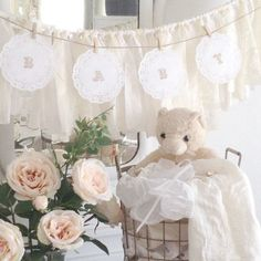 You will adore this sweet and simple DIY paper doily baby banner. It would be perfect for any rustic, vintage, or Shabby Chic style of baby