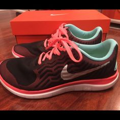 Nike Free 4.0 NIB women's size 7.5 Nike free runs. Black with coral and Aqua. No trades Nike Shoes Athletic Shoes