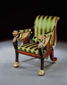 Painted Reclining Chair - early 19th century parcel gilt rosewood & bronze. Designed by William Pocock, upholstered in green & gold Regency stripe fabric, having a scrolled back, joined to the arms by means of an ingenious ratchet mechanism released by pulleys hidden within the rosewood sides, with gilt ovals & pendent gilt apron, & leopard monopodium front legs, each with an anthemion decorated breast & applied with wings, terminating in paw feet with concealed castors & sabre legs, w…
