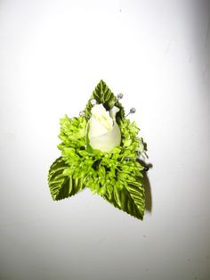 white rose with green hydrangea boutonniere