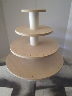 New Item.  DIY Unfinished 4 Tier Round or Square Convertible Cupcake or Cake Pop Stand.  Plain No Paint.. $82.00, via Etsy.
