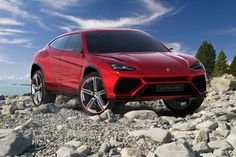 Lamborghini's long-awaited SUV will enter production this year     - Roadshow Lamborghinis never officially committed to building a sport utility vehicle before but that changed this year. Its coming.  The supercar manufacturer will start production on its first ever SUV later this year Digital Trends reports citing its interview with Stefano Domenicali Lamborghinis CEO. The chief executive not only confirmed its production he also confirmed itll be called the Urus  a name you may remember…