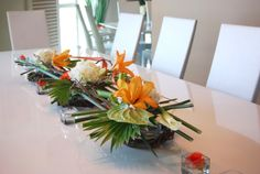 Simple Oriental Style designs for your dinning table set up. Adorn your bowls and displays with flowers and greens.