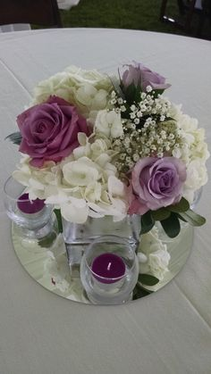Loved it! Pinned it! A Blooming Envy Design! Centerpiece with White Hydrangeas, Purple Roses - Cool Water and Ocean Song varieties, and Baby's Breath