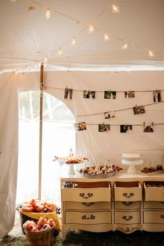 Backyard wedding dessert display idea - twinkle lights with photos + vintage wooden dresser {Apaige Photography}