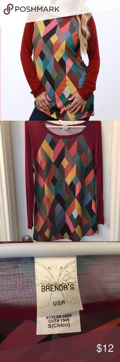 Fun, Geometric Tunic This eye-catching tunic revs up your casualwear rotation with a touch of standout style! Wear with jeans or leggings or pair with some shorts when the weather warms up. Brenda's Tops Tees - Long Sleeve