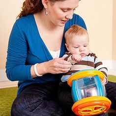 <p>Show+your+baby+how+different+objects+have+different+sounds+by+comparing+a+bell+to+a+rattle+or+a+drum.</p>
