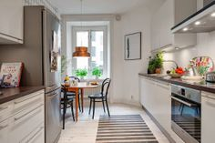 A touch of colour in a light and airy Swedish home