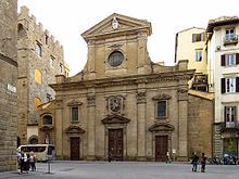 Santa Trinita -  is a Roman Catholic church located in front of the Piazza of the same name, traversed by Via de' Tornabuoni, in central Florence, region of Tuscany, Italy. It is the mother church of the Vallumbrosan Order of monks, founded in 1092 by a Florentine nobleman. South on Via de' Tornabuoni is the Ponte Santa Trinita over the river Arno; across the street is the Palazzo Spini Feroni