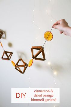 Make a cinnamon himmeli & dried orange garland with this easy holiday home decor DIY project.