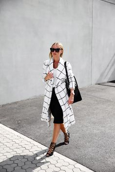 Black and white summer fashion is all the rage. This outfit may be too hot for a summer day but is perfect for a spring one! Dress down the trench coat look with a mid length skirt or capri and a pair of summer heels. #OOTD #NuFACE
