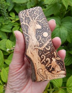 'Spirit of the Forest of Dreams'  'The Forest of Dreams' is part of my personal myth. Many strange characters and tales arise in my mind from this place. It is a fertile creative ground from which I draw inspiration for drawings and verses.. Pyrography on Pyracantha.11 x 4.5 cm  Wording on base: 'I am the Spirit, Light and Life of the Forest...I am the breath of the World.'    G.M.R.2015