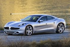 10 Sexy Eco-Friendly Cars   Fisker Karma  What would you expect from the man who designed the Aston Martin DB9 and V8 Vantage? Henrik Fisker's beautiful plug-in hybrid is good for 403 horsepower, which is derived from a four-cylinder engine mated to four electric motors, and it's designed with earth friendly materials inside (without sacrificing luxury) and a solar-cell roof. But the Karma also plays hard to get:
