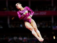 Aly Raisman of Team USA tumbles during her floor exercise routine in the women's gymnastics all-around final at the London Olympics.