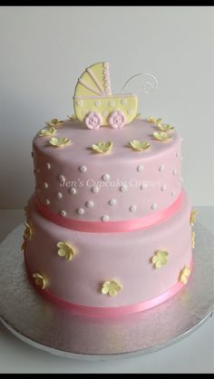 Baby shower cake girl; i like the top tier but white frosting and pink dots and flowers with booties instead