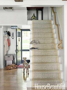 Nautical paneling, beachy floors and stair runner and rope banister.
