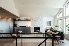 cityhomeDESIGN midcentury remodel - great room with original fireplace, custom cabinetry and vaulted ceilings