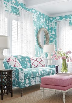 Thibaut chinoiserie inspired wallpaper and Brighton sofa covered in upholstery in South Sea fabric with pink fabric bench white bamboo legs | The Decorating Diva, LLC #aqua #blue #color #decorating #wallpaper #sofa #flowers