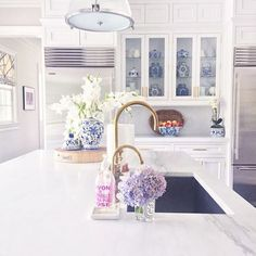 white kitchen with blue ginger jars