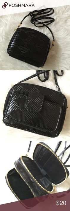 • Mini Black crossbody bag • Brand new. Cross body or can be worn on one arm, one side has space for cash/credit cards. The other is for misc items. Cute little bag! No trades Bags Crossbody Bags