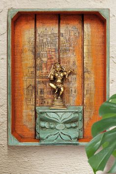 Brass Bal Gopal on carved wooden pedestal with ancient Indian city as backdrop - Selecting rare art from different parts of India to create unique scintillating pieces of decor… - Indian Wall Decor, Indian Home Decor, Vintage Walls, Vintage Art, Vintage India, Home Decor Furniture, Home Decor Items, Pedestal, Antique Wall Decor