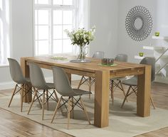 Photo of Ex-display madrid 200cm solid oak dining table with with 6 mink grey charles eames style dsw eiffel chairs