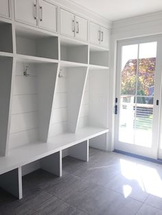 i love this idea for an organized mudroom! These cubbies are amazing.