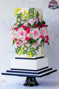 Brightly Colored Cascading Flowers Tiered Cake