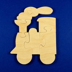 Train Birthday Party Favors - Childrens Wood Puzzles - Package of 10 Deluxe Train Engine Puzzles - Great for Childrens and Toddler Parties. $29.50, via Etsy.