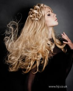 Long hair was basket-weaved through the top with the lengths set on rollers for shape and softness.