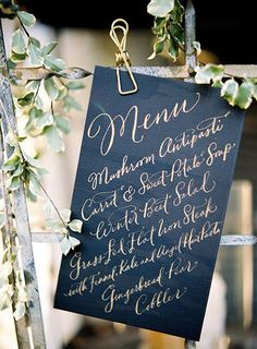 Wedding menus in bold colors and full of gorgeous calligraphy are timeless.