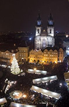 Christmas tree at Old Town Square in Prague, Czechia Prague Old Town, Old Town Square, Night City, Czech Republic, Places To Go, Christmas Tree, Explore, Bucket Lists, House Styles